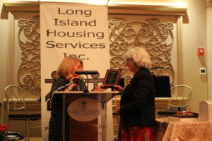 Long Island Housing Services Board President Connie Lassandro presenting outgoing Board President Linda Hassberg with a plaque in appreciation